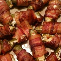 Jalapenos are stuffed with cream cheese, wrapped with bacon, baked, and then finished on the grill. Bacon Wrapped Jalapenos, Stuffed Jalapenos With Bacon, Stuffed Peppers, Recipes Appetizers And Snacks, Great Appetizers, Leftover Brisket, Jalapeno Popper Recipes, Bacon On The Grill