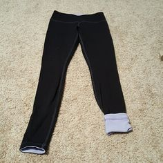 Lululemon reversible wunderunder black/ice blue Black and ice blue (looks lavender ) reversible wunderunder leggings  No pilling on the black side The ice blue side shows pilling No stains Lululemon logo on waist lululemon athletica Pants Leggings