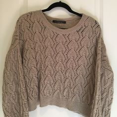 Cropped, boxy crocheted sweater Cropped and boxy sweater with bell sleeves.  Super cute with jeans or a maxi skirt. Sweaters