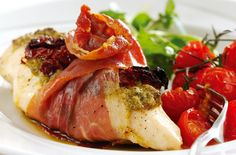 This chicken and Parma ham recipe is delicious served with roasted tomatoes and crisp green salad and is one of your all-time favourite stuffed chicken breast recipes!