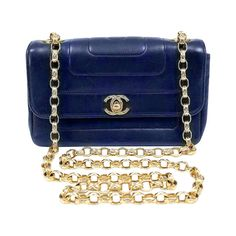 Chanel Navy Vertical Quilted Vintage Bag | From a collection of rare vintage handbags and purses at http://www.1stdibs.com/fashion/accessories/handbags-purses/