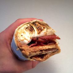 S'mores: now in bacon burrito form! A classic s'more, rolled in a tortilla with bacon, and peanut butter and jelly added. Chocolate Graham Crackers, Chocolate Marshmallows, Delicious Desserts, Dessert Recipes, Yummy Food, Yummy Recipes, Keto Recipes, Bacon Jalapeno Mac And Cheese, Desert Recipes