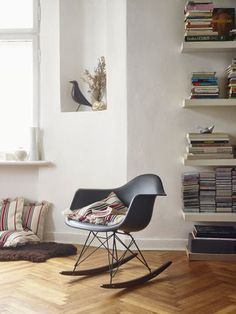 molded plastic rocking chair and an Eames House Bird Plastic Rocking Chair, Eames Rocking Chair, Eames Chairs, Upholstered Chairs, Eames Rar, Dining Chairs, Plastic Chairs, Eames Rocker, Lounge Chairs