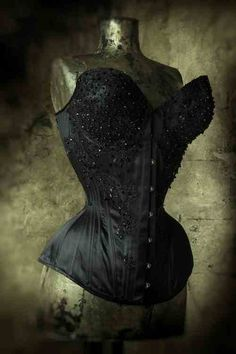 A bespoke, black, silk duchess corset with cups and embellishment, by Sparklewren.