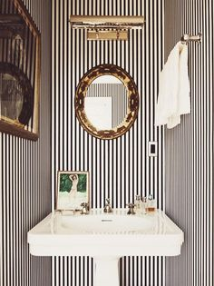 Powder room inspiration- love the stripes mixed with brassy-goldish accents, the light and pedestal sink. Kate and Andy Spade's striped powder room. Bad Inspiration, Bathroom Inspiration, Interior Inspiration, Travel Inspiration, Home Design, Interior Design, Design Ideas, Design Room, Interior Decorating