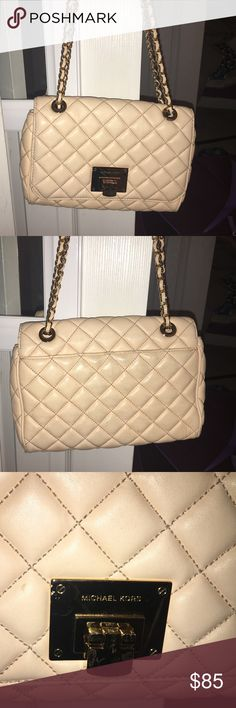 Micheal Kors Sloan bag This is a pale pink MK bag. 100% authentic. Purchased at my local mall. Has some wear on it and staining on the back that can be cleaned off with some kind of solution I'm sure. Other than that it's in good condition and a gorgeous bag for spring or summer. Michael Kors Bags Shoulder Bags