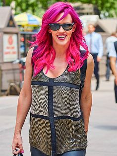 Pink hair, Jenny McCarthy doesn't care! The normally blonde bombshell confidently flaunted neon tresses in the rosy hue not to mention classic wayfarers!