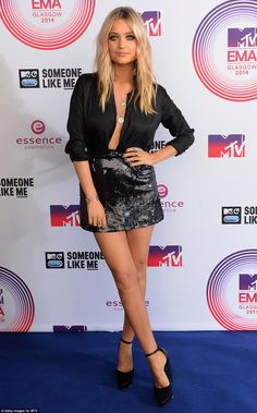 Revealing: MTV presenter Laura Whitmore went for a daring look, that included an undone blouse tucked into a sequinned mini-skirt, revealing her cleavage and toned torso