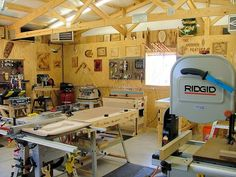 DL - notice the moveable outfeed table, built on power tool stand, easy to move to right side table saw extension table. notice the maget-sided pushstick hangin off the drill press.