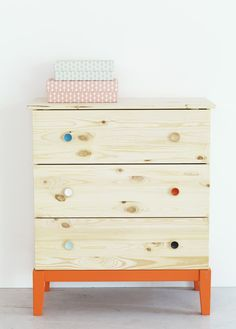 i like how this is IKEA piece is styled with pops of colour against the natural woodgrain.