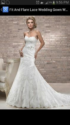 Lace, a-line front but trumpet back. Scalloped sweet heart neckline. Beautiful!