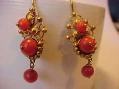 The red coral, gemstone or Moonga stone transmits cosmic energy, which proves highly beneficial to cure serious diseases related to the brain. Jewelry Design Earrings, Agate Jewelry, Gold Earrings Designs, Coral Earrings, Coral Jewelry, India Jewelry, Gold Jewellery Design, Beaded Jewelry, Victorian Jewelry