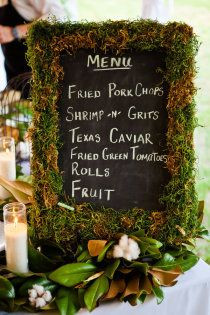 moss,magnolia leaves, and cotton menu board layout