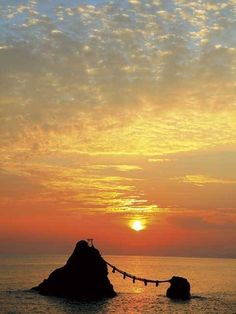 Meoto (meaning Husband & Wife) rock & sunset, in Ise *-*.(Futami  Mie ).  In Shinto, everything has 'kami' or spirit.  So these  male and female rocks are married to each other.
