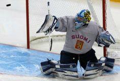 finland womens ice hockey | Goalkeeper of Finland's women's ice hockey team Raty Noora eyes a puck ...
