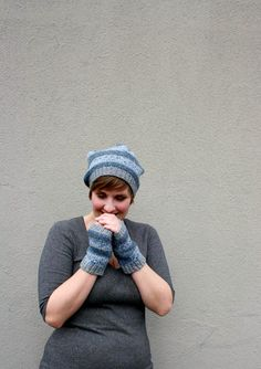 Stripey knit hat and fingerless gloves in blue and gray shades. <3