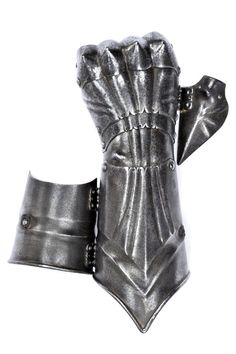 A rare and early right-hand gauntlet Germany, circa 1500 Cuff with grooves and raisers, with recessed border and margin bent toward the outside, three-plate back decorated en suite with chiselled and pierced borders, the central one with a bump, pointed knuckles, no fingers but the thumb.