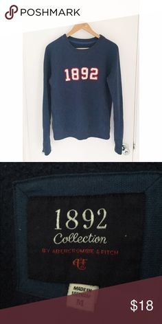 Navy blue oversized crewneck sweater Very thick (inside feels like fleece) and warm crewneck sweater from A&F . Design is sewn on not printed so it won't fade . Sz M but it's loose fitting . Only worn once so it's pretty much brand new . Abercrombie & Fitch Sweaters Crew & Scoop Necks