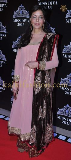 http://www.kalkifashion.com/ Zeenat Aman in pink anarkali suit attending the Miss Diva 2013 event.