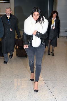 Kim wore her J Brand Photoready Cropped Skinny Jeans in Mercy, pairing them with a leather jacket and a furry scarf.