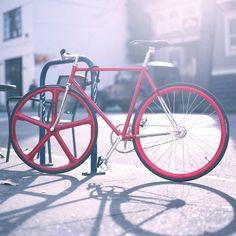 red frame/wheels/grip, black tyres/seat