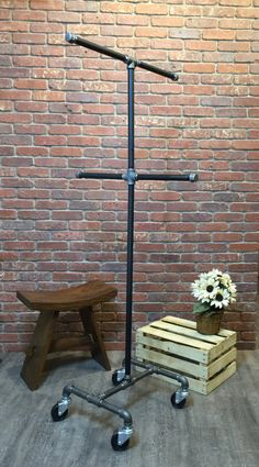 gypsy setup Industrial Pipe Clothing Rack by William Robert's Vintage This Pipe Clothes Rack is made using black pipe and pipe fittings. This extremely durable and long-lasting design is g Rolling Clothes Rack, Pipe Clothes Rack, Rustic Clothes Racks, Industrial Pipe, Industrial Style, Vintage Industrial, Clothing Storage, Clothing Racks, Size Clothing