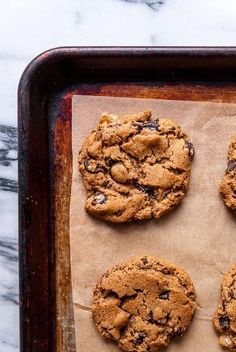 Vegan chocolate chip cookies with a ginger kick and sweetened with pure maple syrup! Easy and quick to make for all your vegan baking needs.