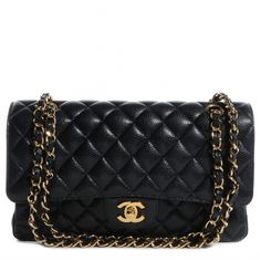 This is an authentic CHANEL Caviar Medium Double Flap in Black.   This is a stylish and popular classic shoulder bag constructed out of luxurious black caviar leather with iconic diamond shaped stitched quilting.