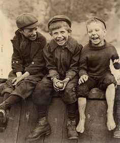 These three young friends sitting on fence have lots of fun. I likes Vintage photos that transport us to another time. Economic reality, technological and dress is so different and nevertheless these boys are obviously happy.