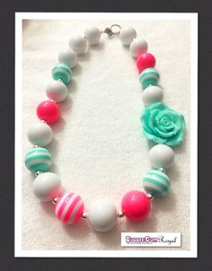 Our Rosey Rose Aqua Bubblegum Bead Necklace with pink, aqua and white beads and featuring an aqua 3D rose for just $16.50 including shipping (untracked) anywhere in Australia. More designs available at www.bubblegumroyal.com