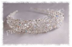 This is my Grace tiara, one of my favourites! Encrusted with Swarovski crystals, Semi - precious Rock crystal quartz  and AB coated glass silver seed beads.... Available from my website www.preciousaccessories.co.uk