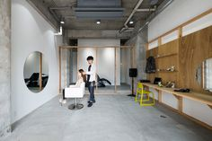 Equip salon by Sides Core.  There is room for just one customer at a time in this minimally furnished Osaka hair salon, which Japanese studio Sides Core claims was inspired by the principles of mountain climbing.  The owner chose to only have one guest at a time to make sure that they can have time without having to concentrate on other people.