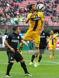 Pedro Mendes (R) of Parma FC is challenged by Xherdan Shaqiri (L) of FC Internazionale Milano during the Serie A match between FC Internazionale Milano and Parma FC at Stadio Giuseppe Meazza on April 4, 2015 in Milan, Italy.
