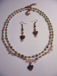 This is a lovely, feminine jewelry set by Donna which has two separate adjustable-length beaded necklaces as well as matching earrings. The