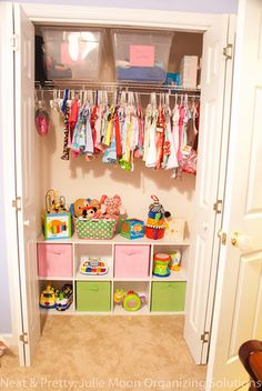 If you have lots of empty room in the bottom of a closet...turn it into a toy storage area. Love this!