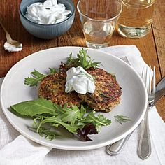 Zucchini, Walnut, and Feta Cakes with Cucumber-Yogurt Sauce | Cooking Light. Uses quinoa instead of flour or breadcrumbs for a GF dish.  Plus, a plate packs a days worth of veggies - 2 1/2 cups.
