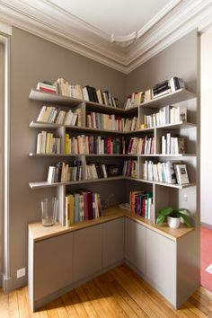 Mora | Archipelles PARIS Agency Angle bookshelves, library and cabinets.