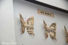 """Detail of my """"Ave Maria"""" butterfly shadow box I created from vintage sheet music."""