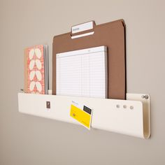 Pocket Strip Wall Organizer - See Jane Work I really like the idea of this - I am not sure where I would use because I don't like to see paperwork out in the open, but between the holder and the magnets, it serves a few functions. Very neat!