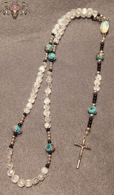Teal & Clear Crystal Rosary  Visit www.twistedthingamajigs.com to place your order and see more of our merchandise.