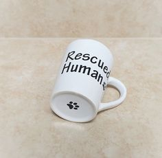 Quote Coffee Mug For Dog and Pet Lovers. Custom Quote Mug Rescued Human. Ceramic Coffee Mug Makes Great Dog Lover Gift for Christmas!  Happy Dog Hydrants Rescued Human Coffee Mug! We love our coffee and tea too and are happy to create mugs for Dog Lovers everywhere! Our Mug is a Sturdy Ceramic Stoneware Mug. This Large mug holds 14 ounces (415 ML). This Mug design is read from left to right by the user when in users RIGHT hand. You may also chose the option for a mug that will be read by…