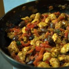 Mediterranean Chicken Recipe Main Dishes with olive oil, white wine, boneless skinless chicken breast halves, garlic, diced onions, tomatoes, white wine, chopped fresh thyme, fresh basil, kalamata, fresh parsley, pepper, salt
