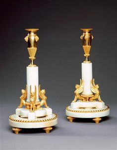 A PAIR OF EMPIRE PERIOD SWEDISH MARBLE CANDLESTICKS