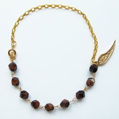 Natural brown faceted tigereye, candy color gemstone bracelet with 24 K gold plated wing charm, multi-color available, FREE shipping #christmas #xmas #halloween #highquality #affordable #freeshipping #bead #beads #gem #gems #gemstone #gemstones #jewelry #jewellery #jewelrymaking #jewelrysupplies #jewelrysupply #etsy #farragem #design #designer #handcrafted #handmade #ring #necklace #earrings #bracelet #pendant 24k Gold Jewelry, Jewellery, Unique Jewelry, Ring Necklace, Beaded Necklace, Earrings, Natural Brown, Gemstone Bracelets, Candy Colors