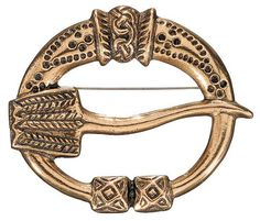 """""""VIRUSMÄKI BROOCH, material: bronze or silver. The prototype for this horseshoe-shaped brooch dating from the 1000s was originally made of partially gilded silver. The surface of the rim and the pin are adorned with circles and lines of dots and braiding. A thicker section in the centre of the brooch is decorated with a runic animal figure."""""""