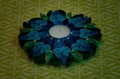 mystique blue-This collection is inspired by nature!! Our choice of color, embellishment & design is pre dominantly Indian.These water resistant quilled candle holders are great option They make good decorative item or you can just pick them for gifting..Each one is handmade by using paper strips, quilled to get desired designs.  www.facebook.com/craftstruck  craftstruck2012@gmail.com  #quilledart #quilling #quilledcandles #quilledtealightcandle #craftstruckdesignstudio #quilledhomedecor