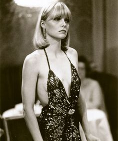 If there is one movie character that personifies the disco couture era, then that's Michelle Pfeiffer (as Elvira Hancock) in Scarface. Elvira Hancock, Michelle Pfeiffer Scarface, Gwyneth Paltrow, Studio 54 Fashion, 70s Fashion, Studio 54 Style, Icon Fashion, Seventies Fashion, White Fashion