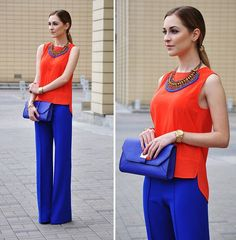 cobalt pants outfit with orange top and cobalt clutch