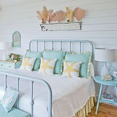 Beachy bedroom featuring wrought-iron painted bed, breezy curtains and shell display above bed on floating shelf- love the iron bed frame Beach Inspired Bedroom, Beach House Bedroom, Beach Room, Beach House Decor, Home Bedroom, Home Decor, Seaside Bedroom, Dream Bedroom, Beach Bedroom Decor