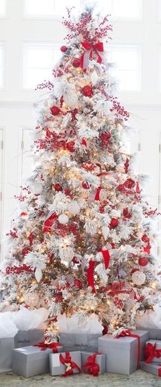 Warm & Festive Red and White Christmas Decor Ideas - Hike n Dip Give your Christmas decoration a festive touch. Try the classic Red and white Christmas decor. Here are Red and White Christmas decor ideas for you. White Christmas Tree Decorations, Flocked Christmas Trees, Beautiful Christmas Trees, Christmas Room, Magical Christmas, Diy Christmas Tree, Christmas Tree Toppers, Christmas Mantles, Christmas Villages